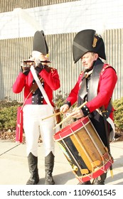 Frenchtown, MI/USA: Jan. 20, 2018 – Battle of River Raisin in War of 1812 re-enactment. American Militia Musicians' coat colors were the reverse of soldiers whose coats were blue with red trim.