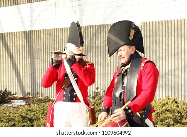 Frenchtown, MI/USA: Jan. 20, 2018 – Two musicians dressed to participate in re-enactment of Battle of River Raisin in War of 1812, playing flute and drum as American Militia Musicians .
