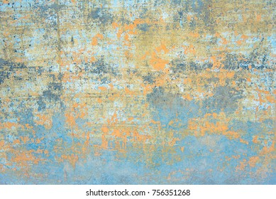 Fresco background - Background of an old wall with peeled faded paint in yellow and blue colors. It looks like as part of an ancient mural painting.
