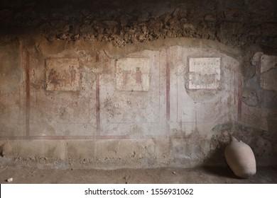Fresco on the wall of villa in Pompeii (Pompei). Ancient Roman city in Pompei, Province of Naples, Campania, Italy