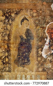 Fresco of standing Buddha inside one of hundred old temples in Bagan, Myanmar