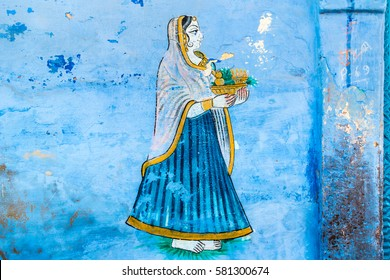 A fresco of a young woman on a wall in Jodhpur, India.