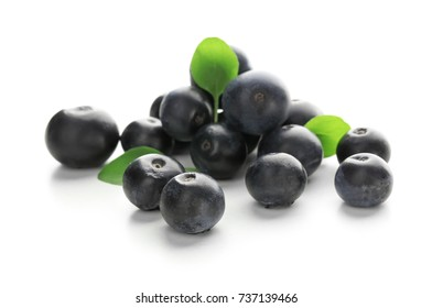 Fresh acai berries, isolated on white