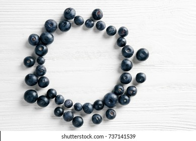 Fresh acai berries on wooden background