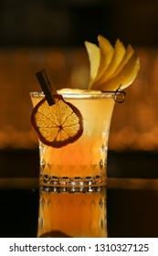Fresh alcohol Penicillin cocktail with orange slice and ice cubes