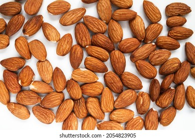 Fresh Almonds, hulled, unshelled. Flat lay composition on a white background.