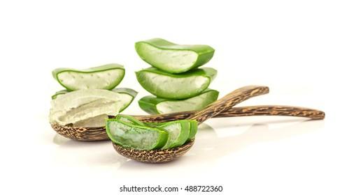 Fresh aloe vera gel on  wooden spoon on white background