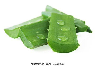 Fresh aloe vera leaves with water drops isolated on white