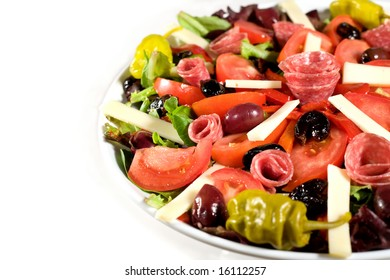 Fresh Antipasto salad with cheese, lettuce, and olives.