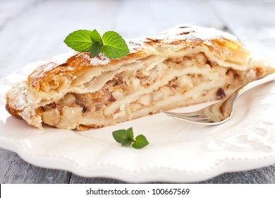 fresh Apfelstrudel with mint on a plate