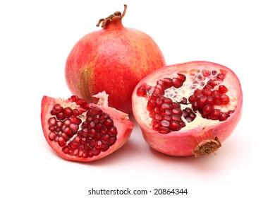 Fresh appetizing pomegranates on white background