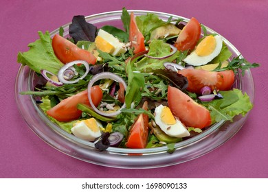 fresh appetizing salad with vegetables and eggs on a plate