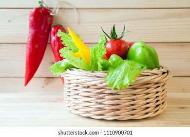 Fresh appetizing vegetables on wooden table