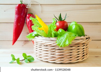 Fresh appetizing vegetables on wooden table