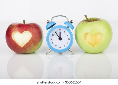 Fresh  apple with a heart shaped cut-out on white background