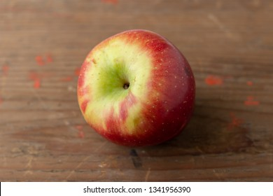 Fresh apple isolated on wooden board