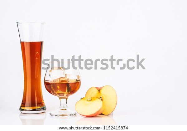 Fresh apple juice from red apples fruits isolated on a white background