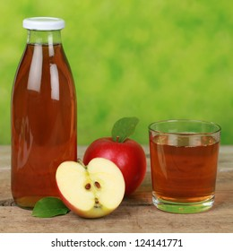 Fresh apple juice served in a bottle and in a glass