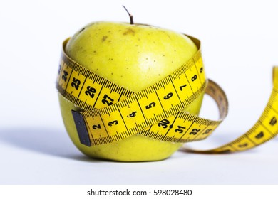 Fresh apple with measuring tape, health concept