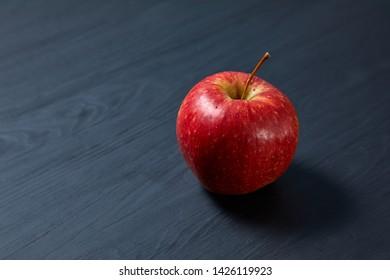 fresh apple on the black background