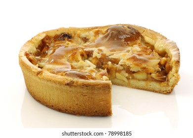 fresh apple pie with one piece missing on a white background