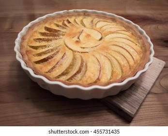 Fresh apple tarte on wooden table from slightly above