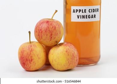Fresh apples and apple cider vinegar in glass bottle