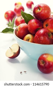 Fresh apples in a bowl over white