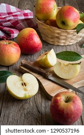Fresh apples on dark wooden table