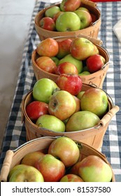 Fresh apples on display at a farmer's market