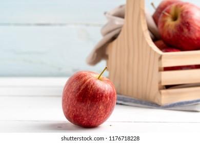 Fresh apples on white table.