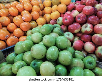 fresh apples, oranges bore  green apple fruits from market ima keithel market manipur