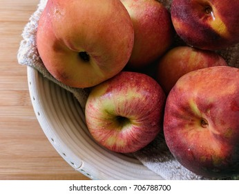 Fresh Apples and peaches in a basket