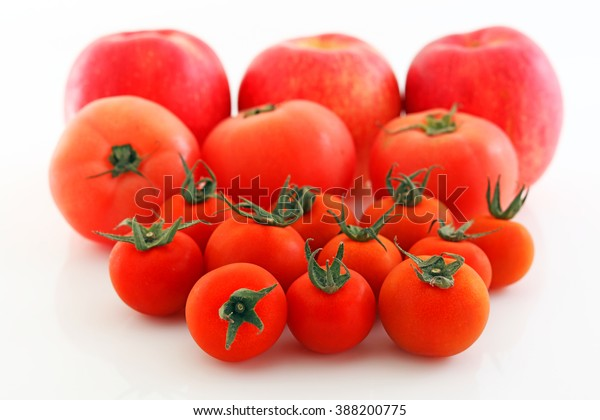 Fresh apples with tomatoes