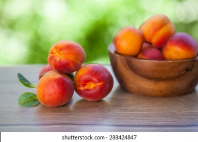 fresh apricot on wood table. Natural background. Selective focus.