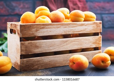 fresh apricot in wooden box, apricots on a table