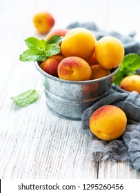Fresh apricots on a old wooden table