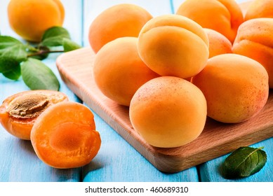 Fresh apricots on a wooden board.