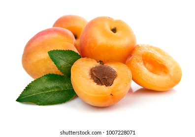 Fresh apricots in section with green leaves still life of ripe fruits, isolated white background.