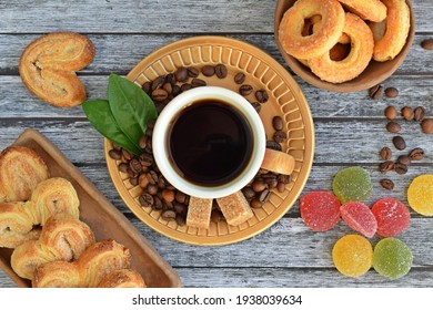 Fresh aromatic coffee and crispy cookies on a wooden background.