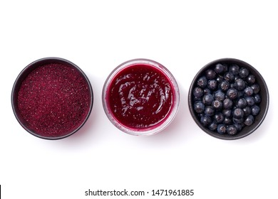 Fresh Aronia berries, powder and jam on white background