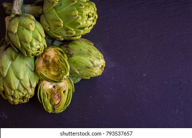fresh artichokes on a dark background