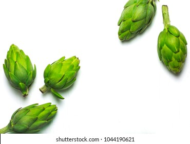 Fresh artichokes on white background with copy space