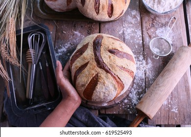 Fresh Artisan Sour Dough Bread on rustic kitchen table.