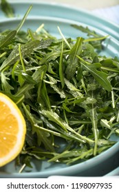 Fresh arugula leaves on wooden bowl, rucola. Arugula rucola on wooden old background.
