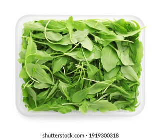 Fresh arugula in plastic container isolated on white, top view