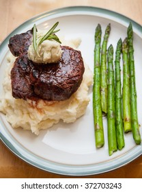 Fresh asparagus with Gorgonzola butter topped filet mignon steak