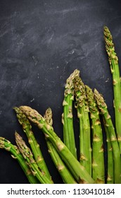 Fresh asparagus on black background