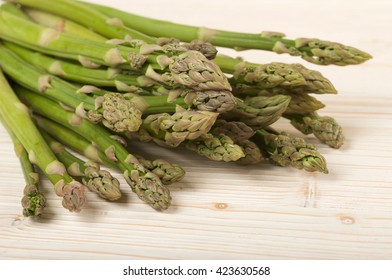 fresh asparagus on a wooden background