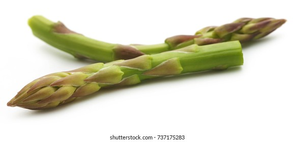 Fresh asparagus over white background